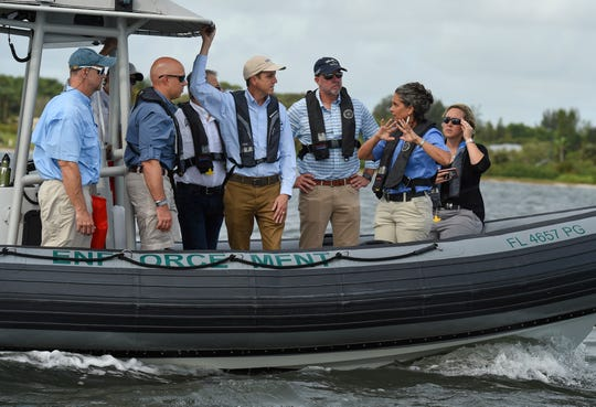 "While touring the St. Lucie River and Indian River Lagoon, (from Left) Jeff Beal, of the Florida Fish and Wildlife Conservation Commission (FFC), U.S. Rep. Brian Mast, James Erskine, FFC, Drew Bartlett, South Florida Water management District, Steve Hudson, FWC, and Jacqui Thurlow-Lippisch, of the South Florida Water Management District, confer on the water conditions of the waterways on Monday, Oct. 7, 2019, in Martin County. ""Crystal, clear water, that's what we saw, crystal clear beautiful water, fish jumping, birds diving for forage fish, it was great,"" Mast said."