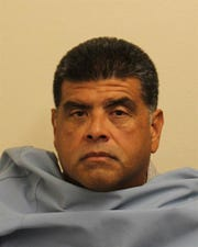 Senior Border Patrol agent Gustavo Zamora, 51, has been charged with sexually assaulting a junior female agent in Arizona. He is pictured in a booking photo.