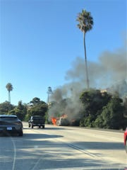 Flames from a burning van on northbound Highway 101 in Ventura Sunday afternoon spread to surrounding brush. At least two fires along the freeway impacted traffic through the corridor.