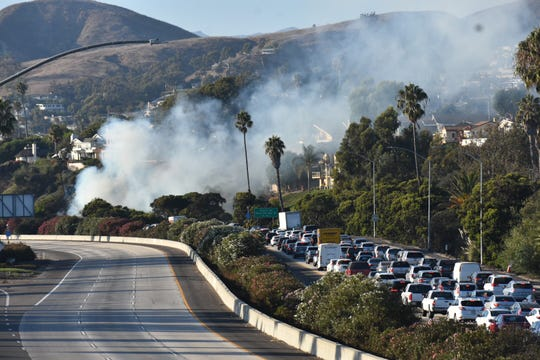 A brush fire was burning near Highway 101 in Ventura on Sunday afternoon.