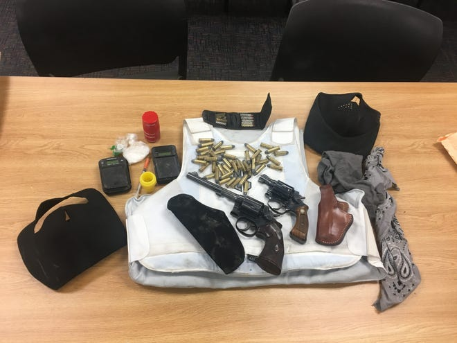 Two guns, a ballistic vest, scales, ammunition and more were seized by Ventura County Sheriff's deputies Sunday in Ventura.