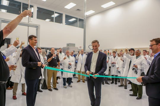 Gerresheimer Chief Executive Officer Dietmar Siemssen cuts a ribbon to officially open the Gx Glass Innovation and Technology Center on West Forest Grove Road in Vineland on Sept. 25, 2019.  At left and right, respectively, are Gerresheimer Glass Inc. President Gary Waller and Gerresheimer Chief Financial Officer Bernd Metzner.