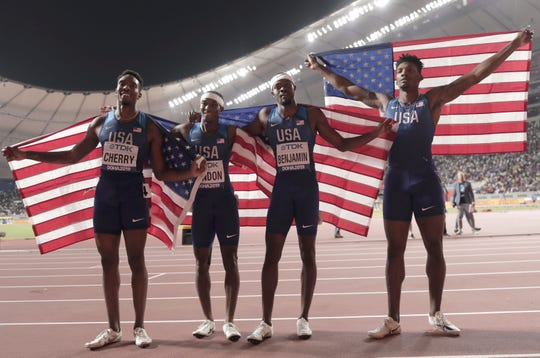 Rai Benjamin, Fred Kerley, Michael Cherry and Wilbert London of the United States after winning the gold medal in the men's 4x400 meter relay final at the World Athletics Championships in Doha, Qatar, Sunday, Oct. 6, 2019. (AP Photo/Nariman El-Mofty)