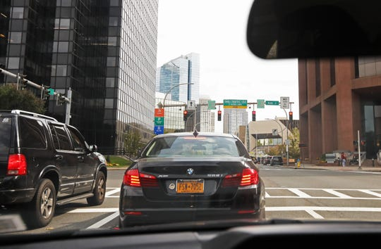 Motorists wait at the traffic light at the intersection of Main and Bank Streets Oct. 7, 2019 in White Plains, where a traffic safety camera was recently installed.