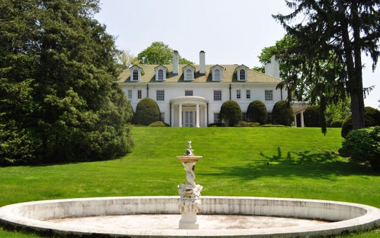 The seller of the 10,566-square-foot estate at 2A Cooper Road seeks $4.95 million for the 10-bedroom property.