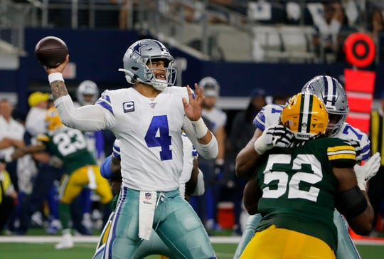 Dallas Cowboys quarterback Dak Prescott (4) throws a pass under pressure from Green Bay Packers' Rashan Gary (52) in the second half of an NFL football game in Arlington, Texas, Sunday, Oct. 6, 2019. (AP Photo/Michael Ainsworth)