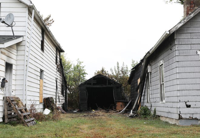 A garage between 113 and 109 Pierce Street in Zanesville caught fire Friday night, and damaged each of the houses beside it.