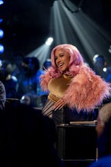 """Cardi B brings plenty of quotable commentary and colorful hairstyles to Netflix's hip-hop competition """"Rhythm + Flow."""""""