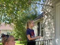 Democratic Party activists Hayley Bird (right) and Joan Garski canvass in Stevens Point, Wis. more than 13 months before the 2020 presidential election.