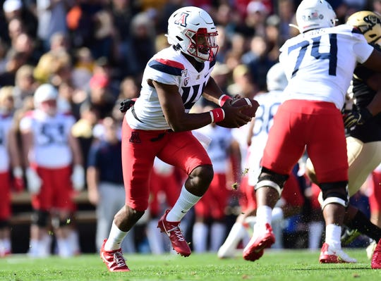Arizona quarterback Khalil Tate carries the ball during the first quarter against Colorado at Folsom Field.