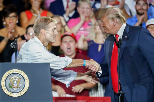 President Donald Trump greets Rep. Jim Jordan, R-Ohio on Aug. 4, 2018, in Lewis Center, Ohio.