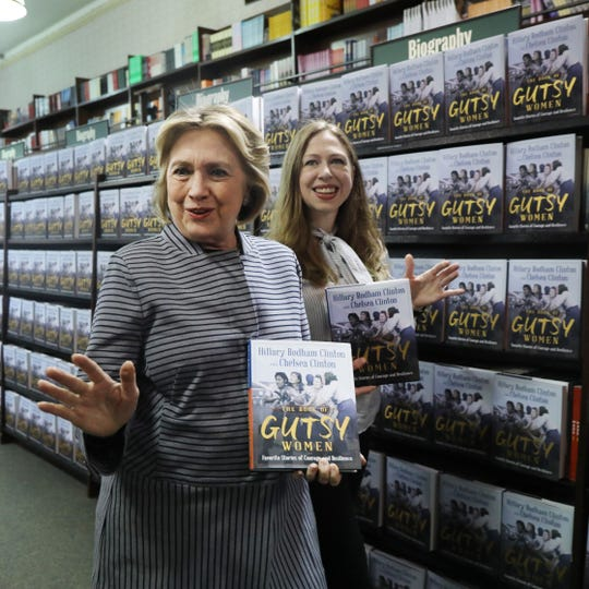 "Chelsea and Hillary Clinton pose with their new book ""The Book of Gutsy Women"" on October 03, 2019 in New York City."