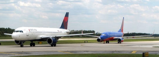 A Delta flight was delayed at Orlando International Airport for nearly three hours Saturday after a woman managed to board a plane to Atlanta without identification or a boarding pass..