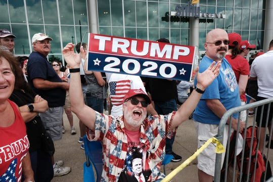 Donald Trump supporters gather outside of an arena in Manchester before a scheduled evening rally by Trump on August 15, 2019 in Manchester, New Hampshire.