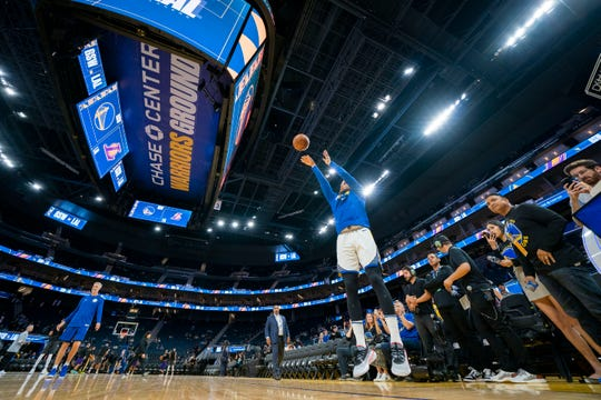 Golden State Warriors guard Stephen Curry warms up before the game against the Los Angeles Lakers at Chase Center.