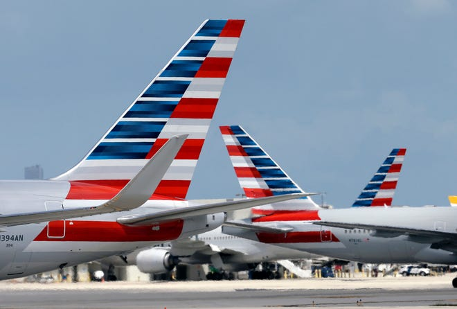 American Airlines jets taxi at Miami International Airport, in Miami.