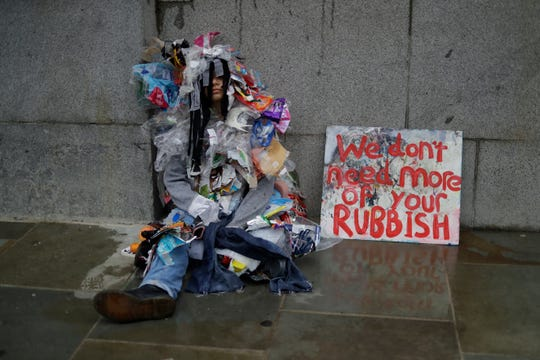 A protester decries climate change outside Britain's Parliament in central London on Oct. 7.