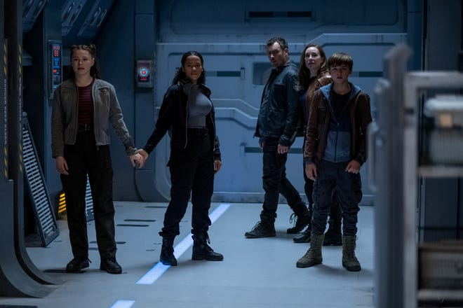 "Penny Robinson (Mina Sundwall), Judy Robinson (Taylor Russell), John Robinson (Toby Stephens), Maureen Robinson (Molly Parker) and Will Robinson (Maxwell Jenkins) in a scene from ""Lost in Space"" season 2 on Netflix."