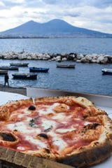 Each country has its iconic quick-and-easy meal. In Naples – it's got to be pizza.  Enjoy yours with a view of Mt. Vesuvius.