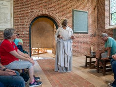 Actress Valarie Gray-Holmes interprets the life of Angela, an enslaved African woman who was brought to Jamestown in 1619, on Saturday, May 11, 2019 in Jamestown, VA. In her story of Angela, Valarie imagines her happy family life in Angola in contrast with her lone and isolated life in Jamestown.