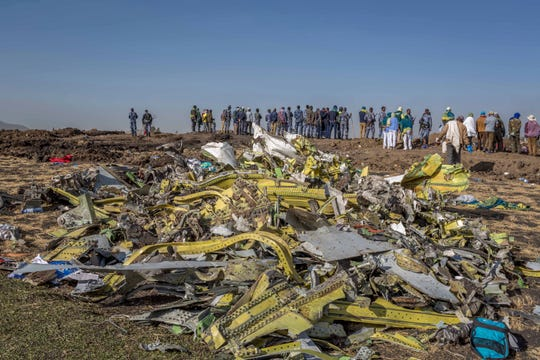 In this March 11, 2019, file photo, wreckage is piled at the crash scene of an Ethiopian Airlines flight crash outside Addis Ababa, Ethiopia. Ethiopian Airlines' former chief engineer Yonas Yeshanew, who is seeking asylum in the U.S., says in a whistleblower complaint filed with regulators that the carrier went into maintenance records on a Boeing 737 Max jet after it crashed this year, a breach he contends was part of a pattern of corruption that included routinely signing off on shoddy repairs.