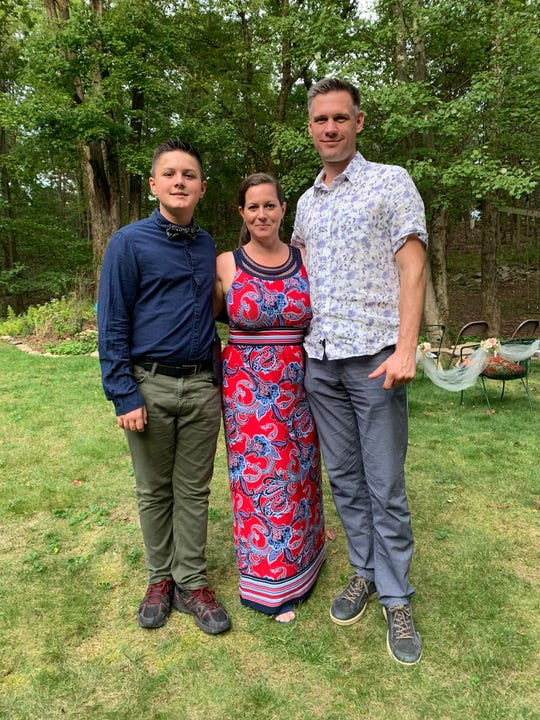 A 2019 photo showing Genevieve Monette with her husband and son in New Jersey.