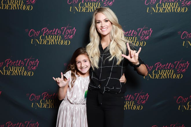 """Savannah Dahan got to meet Carrie Underwood at her D.C. concert. Underwood sang """"The Champion"""" to Dahan's singing in a beautiful moment."""