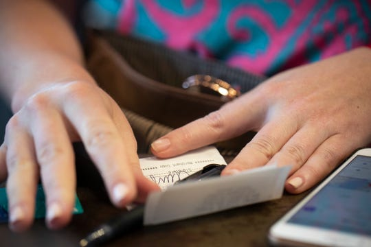 A woman signs a check at a restaurant in New Orleans. Nearly 70% of millennial women have experienced financial abuse by a romantic partner. That means, for every 10 women you know in that age group, odds are that seven of them have had a partner use money to control or manipulate them, according to a 2017 survey of 2,000 people ages 18-35 by CentSai, a financial wellness website.