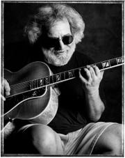 "Jerry Garcia, pictured at David Grisman's house in Mill Valley, California on Sept. 2, 1993 in an image from ""Jerry Garcia: Secret Space of Dreams"" by Jay Blakesberg."