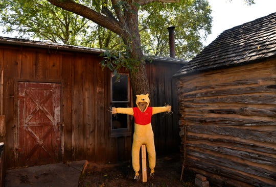 A Winnie the Pooh scarecrow on display at the Taylor County History Center in Buffalo Gap.