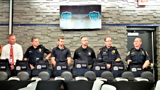 Chief Stan Standridge (left) and other Abilene police officers introduce themselves at an event by Shield 616, an organization that raises money to donate protective gear at no cost to police departments. Funds are collected through individuals, churches, bible study groups, businesses and foundations.