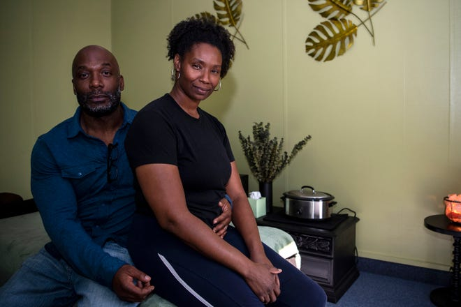 Joyce Wanzer-Weaver poses for a portrait with her husband Dereck Weaver on Tuesday, Oct. 8, 2019 at her spa JQ Massage and Wellness in downtown Battle Creek.