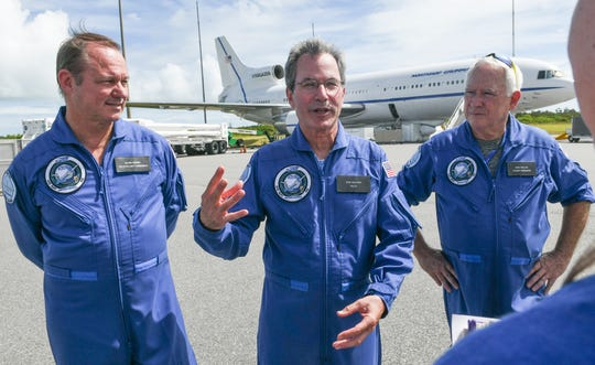 Part of the flight crew of Northrop Grumman's Stargazer L-1011 aircraft talks about tomorrow's air launch of NASA's ICON (Ionospheric Connection Explorer) satellite aboard a Pegasus XL rocket. (L to R) Mark Kennedy, Pilot/Flight Engineer, Don Walter, pilot, Bob Taylor, Flight Engineer.
