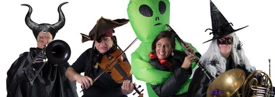 """Space Coast Symphony Orchestra musicians gets ready for """"Chills & Thrills,"""" a family-friendly Halloween concert Saturday, Oct. 19."""