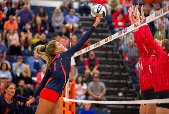 Galion's Samantha Comer hits the ball over Buckeye Central's Alivia Niese and Lauren Mann.