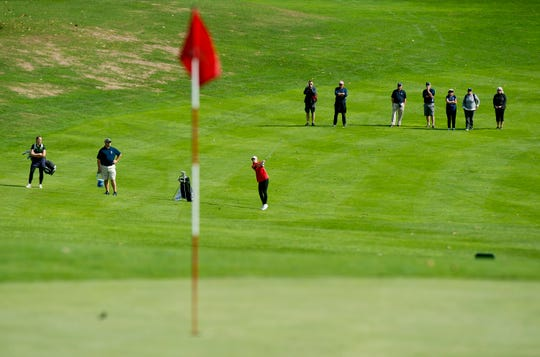 Specators watch as Rutland's Kristen Pariseau, center, hits her second shot on the 16th hole during the Vermont high school girls golf state championships at Proctor-Pittsford Country Club on Tuesday, Oct. 8, 2019.