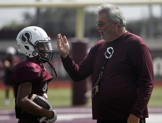 Sinton's offensive coordinator Rod Mounts, left, speaks to Robert Hughes III, Tuesday, Oct. 8, 2019, at Sinton High School. Mounts returned to Sinton as the offensive coordinator with the new head football coach and athletic director Michael Troutman.