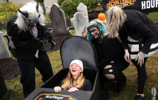 Ally Hoban of Pittsgrove laughs as Six Flags ghouls try to scare her. Park goers are allowed to pose for photos in 2 extra coffins present during the Six Flags 30-hour coffin challenge. Jackson, New Jersey on October 28, 2018.