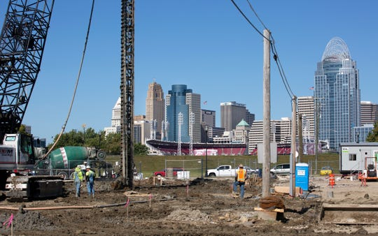 Construction crews work on the new music venue that's part of Ovation development in Newport. It will include parking, an indoor and outdoor music venue and at least two hotels. It will be in view of Cincinnati's music venue that will be next to Paul Brown Stadium. The Kentucky venue to will run by AEG and open in late 2020.