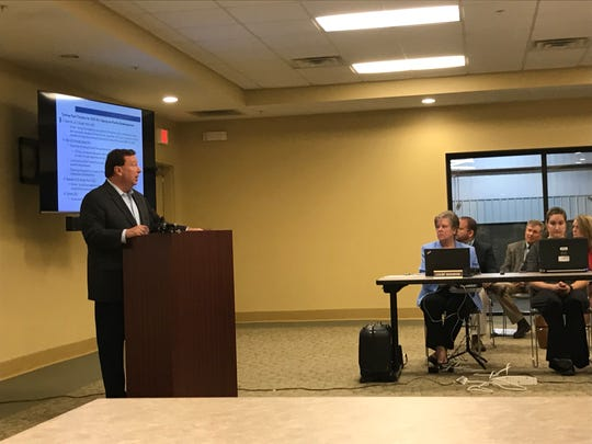 Churchill Downs President Kevin Flanery presents the company's plan to renovate Turfway Park in Florence. The 15-member Kentucky Horse Racing Commission approved Churchill Downs' purchase of Turfway park.