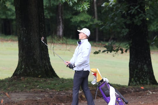 Clarksville High's Aidan Baker watches his chip shot land on the green of the ninth hole during the Region 5 golf tournament at Clarksville Country Club Monday, Oct. 7, 2019.