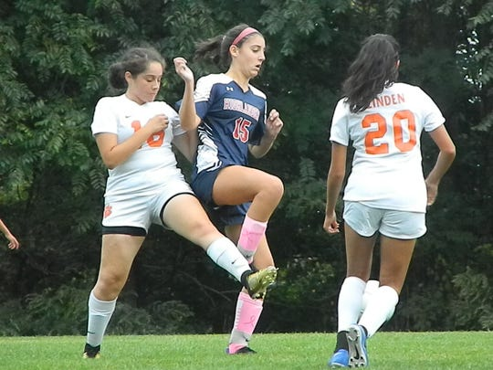Governor Livingston's Caroline Freer (15) tries to work her way around two Linden defenders on Monday, Oct. 7, 2019.