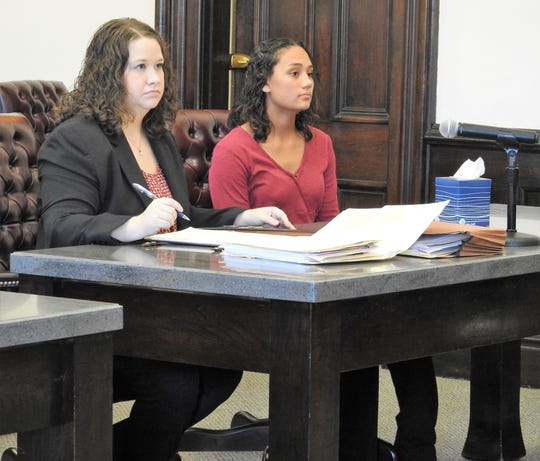 Attorney Diana Dudgeon with client Delany Moore in Coshocton County Common Pleas Court. Moore received a minimum of two years and maximum of three years in prison for burglary, a second-degree felony, when she broke into a home to cause harm to a resident on April 11.