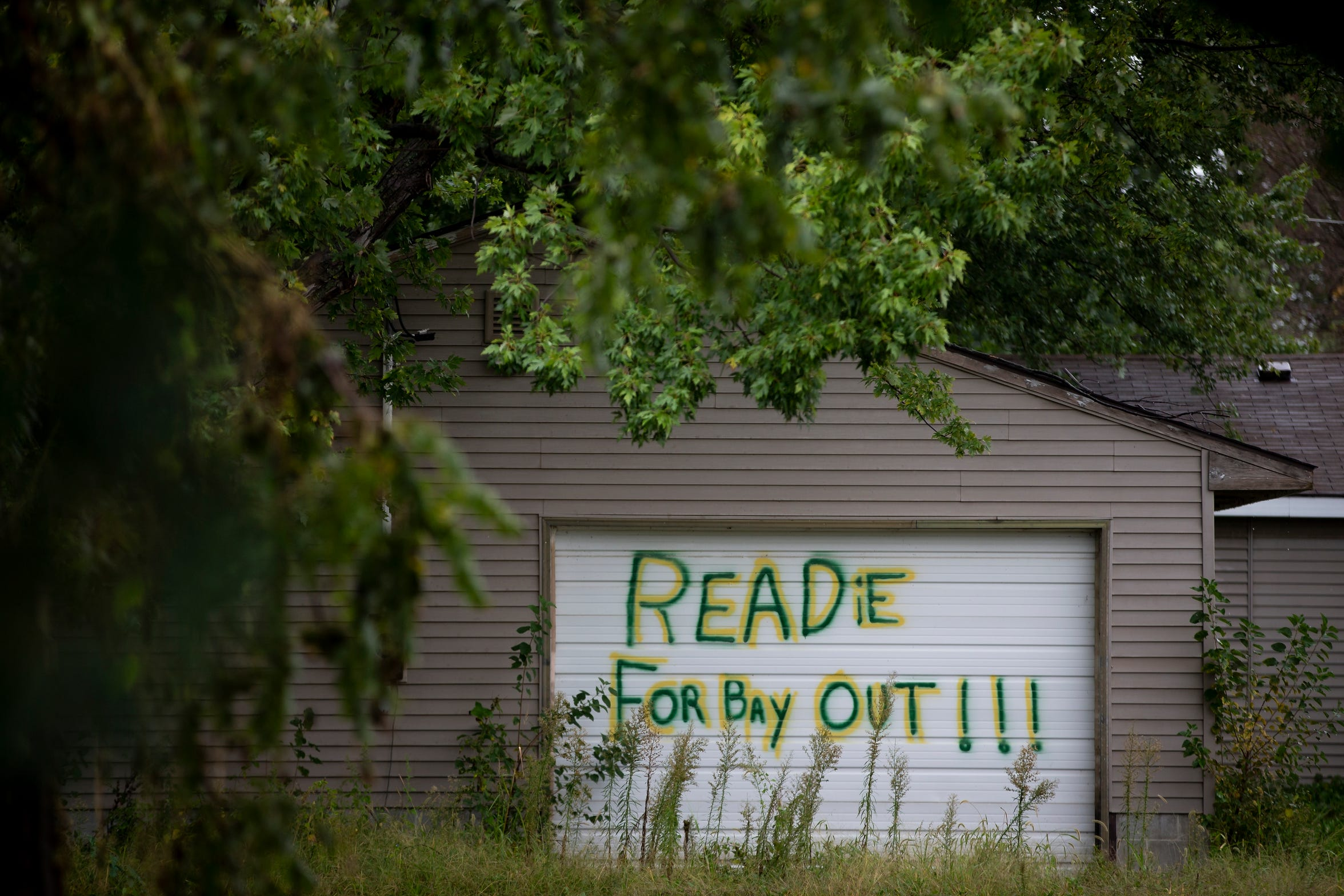 A message scrawled across a garage door expresses the sentiments of many residents in Pacific Junction. The process can take two years.