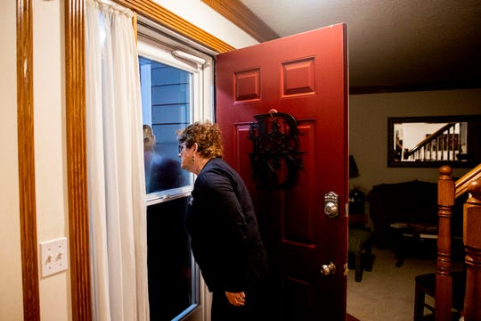 Nancy Bobo, of Des Moines, looks out her window for U.S. Sen. Cory Booker, D-NJ, who, staying in Bobo's home for the night, will be arriving any minute, on Monday, Oct. 7, 2019, in Des Moines.