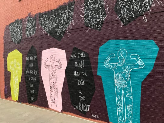 "The mural created in honor of Marsy's Law was defaced in Des Moines' East Village. Marsy's Law is a nationwide movement to give victims the same rights as defendants. The mural comes with the words: ""And the Day came when the risk to remain in a tight bud was more painful than the risk it took to blossom."""
