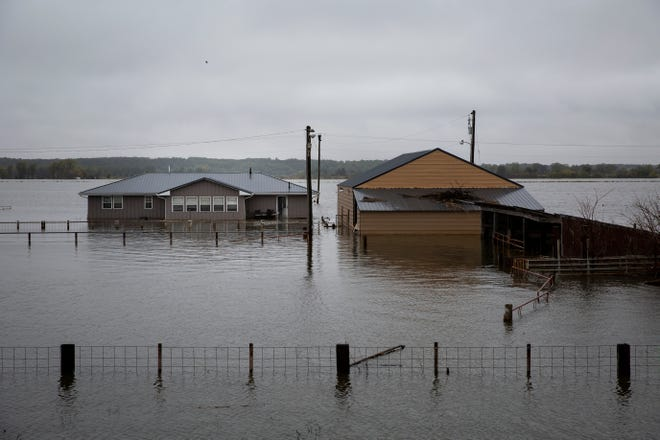 Bailey Bebout's home sits underwater in McPaul. Missouri River floodwaters have inundated it three times this year.