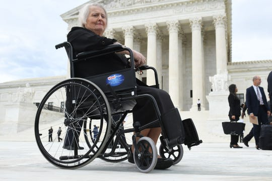 Transgender activist Aimee Stephens, sits in her wheelchair outside the US Supreme Court in Washington, DC, October 8, 2019, as the Court holds oral arguments in three cases dealing with workplace.