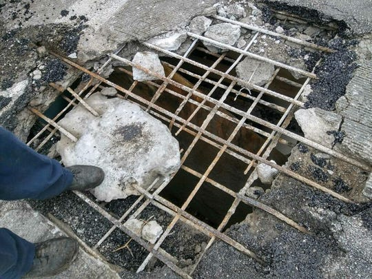 The Michigan Department of Transportation is closing several ramps at the I-96/M-39 interchange in Detroit. Repairs will be made to bridges because of holes like this one from May.