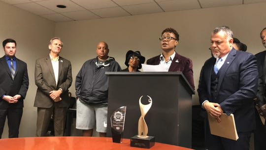 Rhonda Powell, former Macomb County director of the department of health and community service, speaks about a whistleblower lawsuit that she filed Tuesday, Oct. 8, 2019, in Macomb County Circuit Court. She spoke at a press conference in Detroit with her attorney, Nabih Ayad, who is standing with her at the podium.